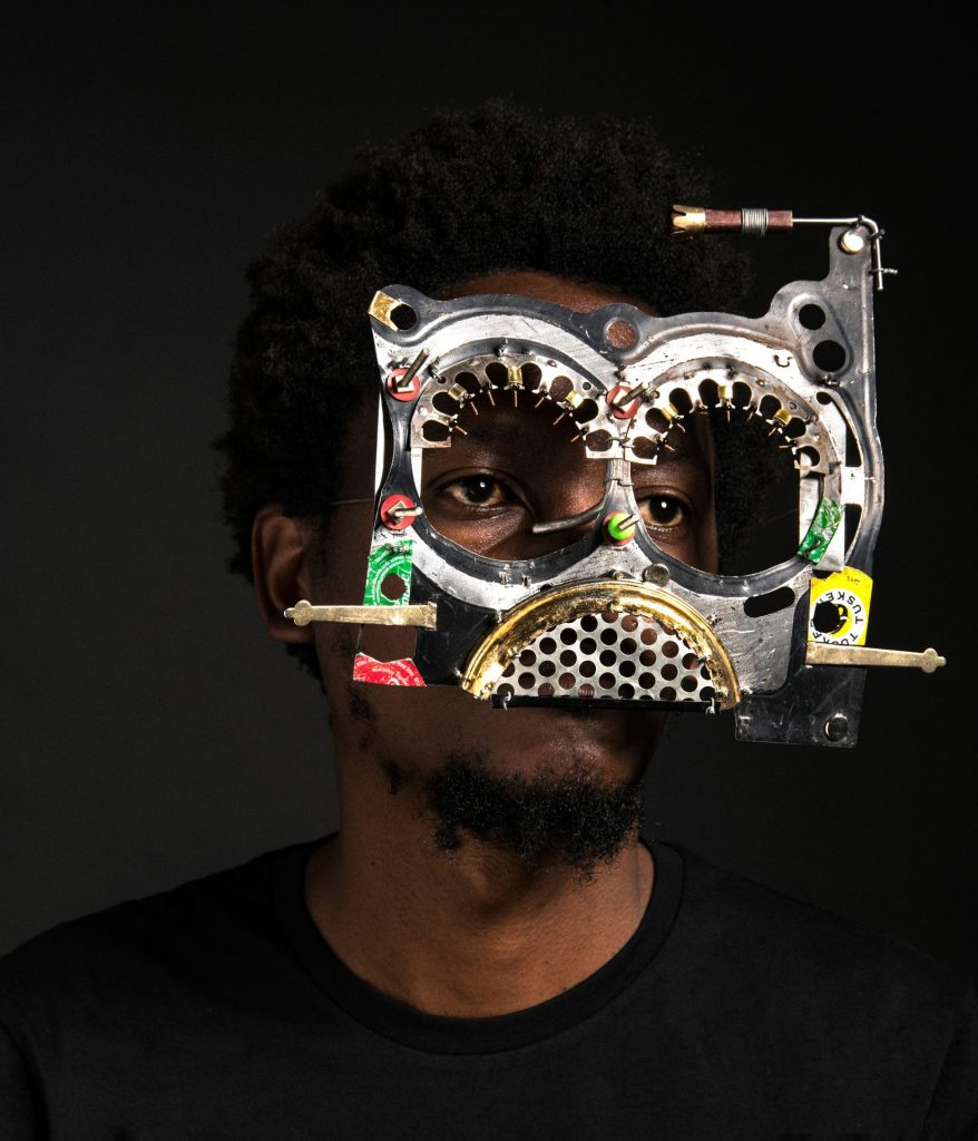 Man wearing a mask made of recycled materials