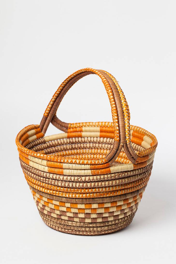 A basket with different patterns and lines in oranges.
