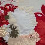 Sequined floral shapes in in red cream and white