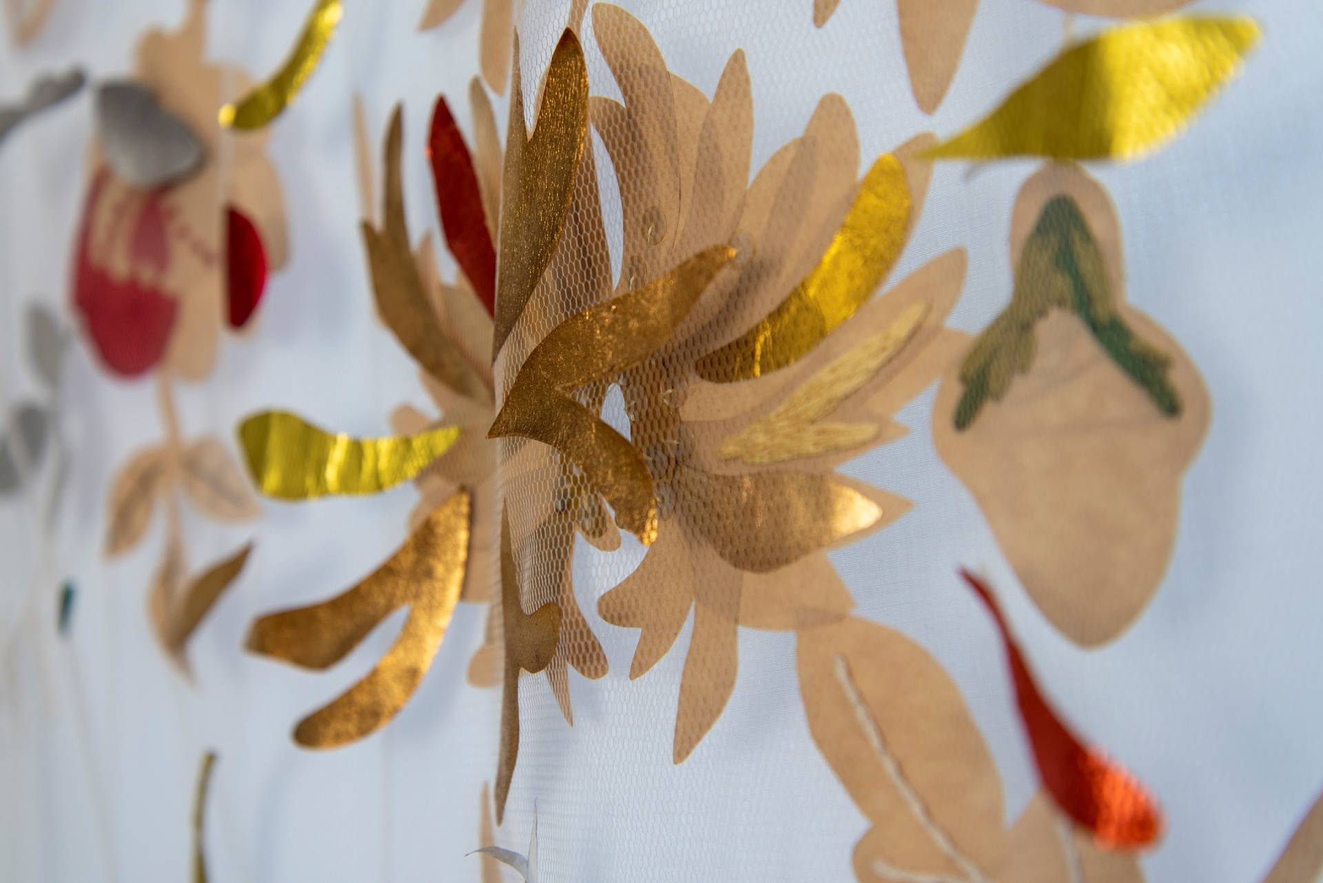 Handmade flowers on mesh with some shimmering gold petals