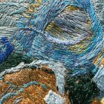 Embroidery thread on linen close up