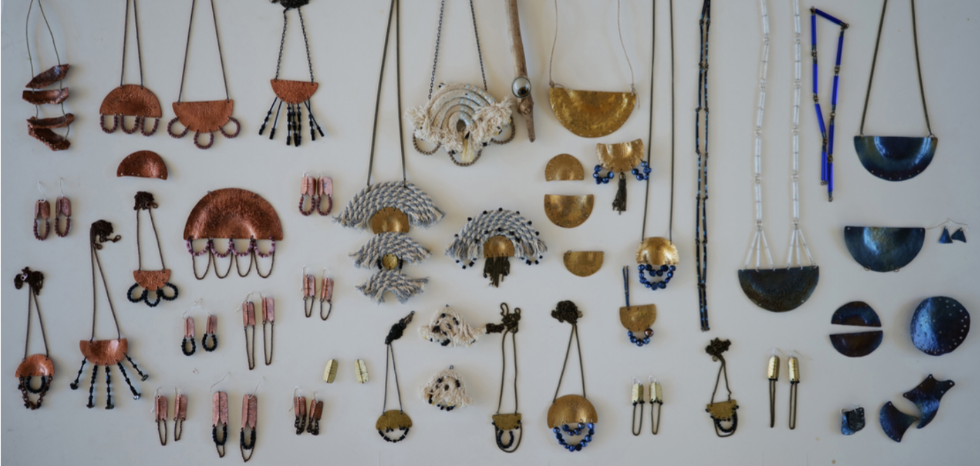 Necklaces and earrings made from different materials in shielding and adorning shapes