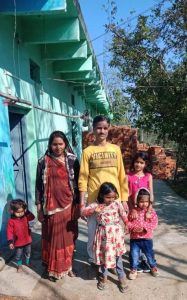 Uday Singh pictured with wife and family outside their home