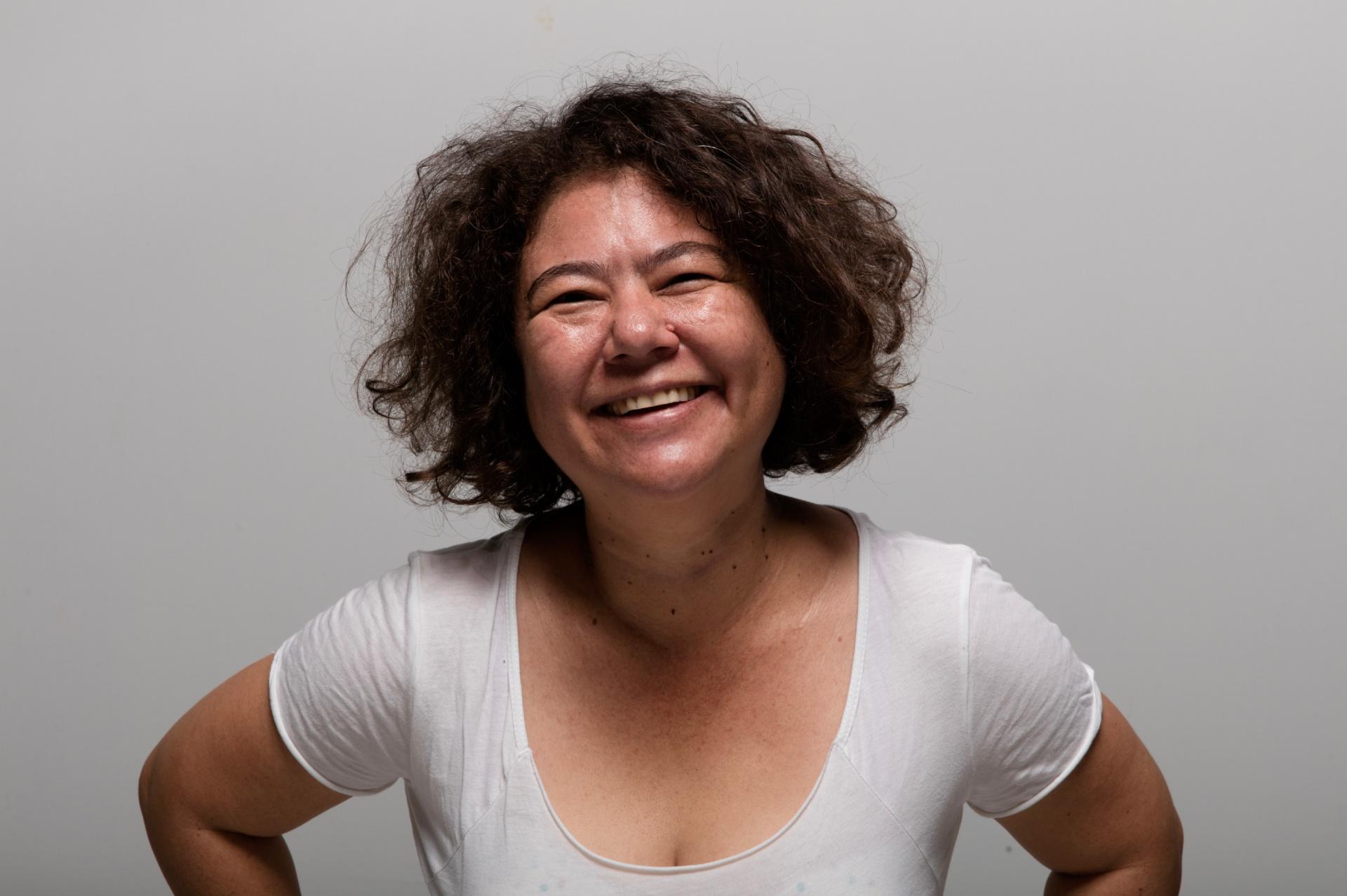 portrait photo of a woman in white t-shirt, I-Lann Yee
