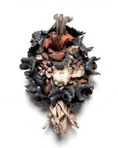 Recycled silver and copper in the shapes of orchid and pawpaw flowers in varying hues