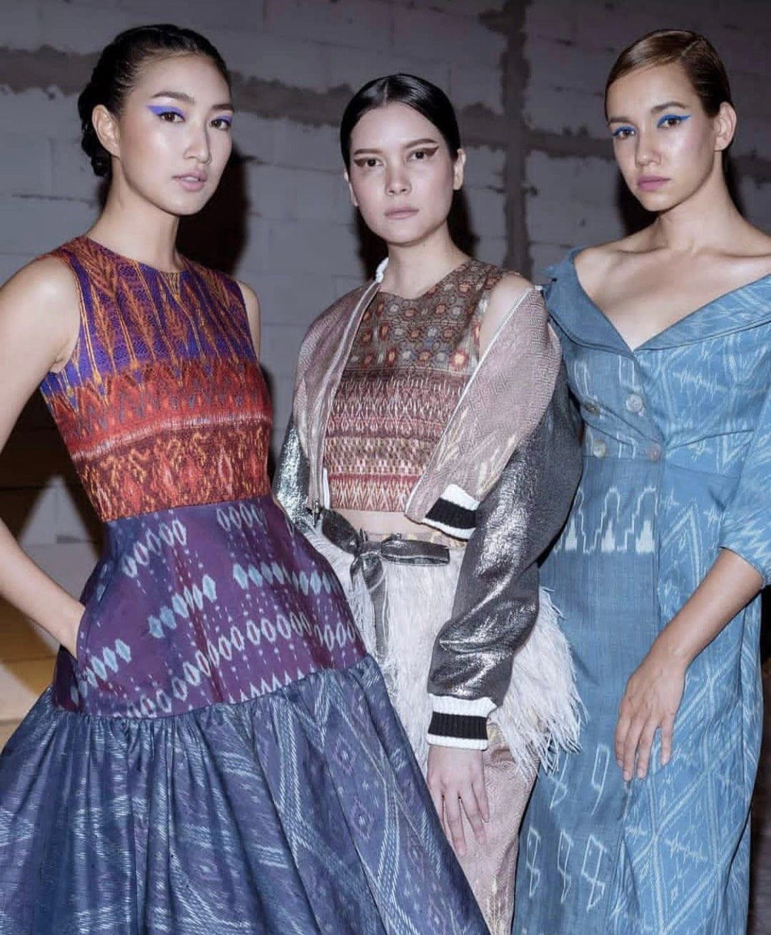 Three models at Queen sirikit department of sericulture presents special fashion show 'SILK ISAN'